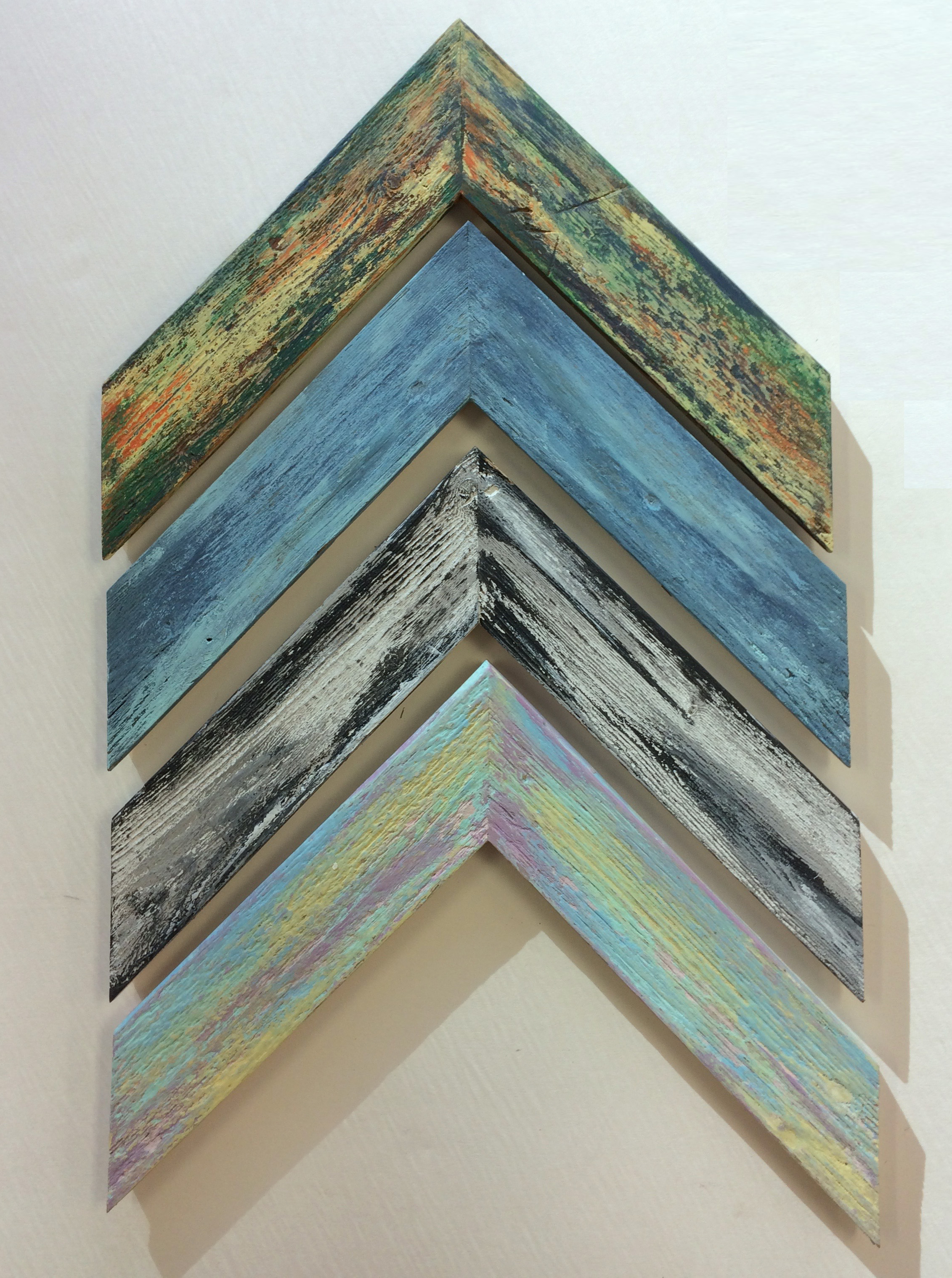 Barnwood repeatedly painted and sanded until the colors are infused into the wood