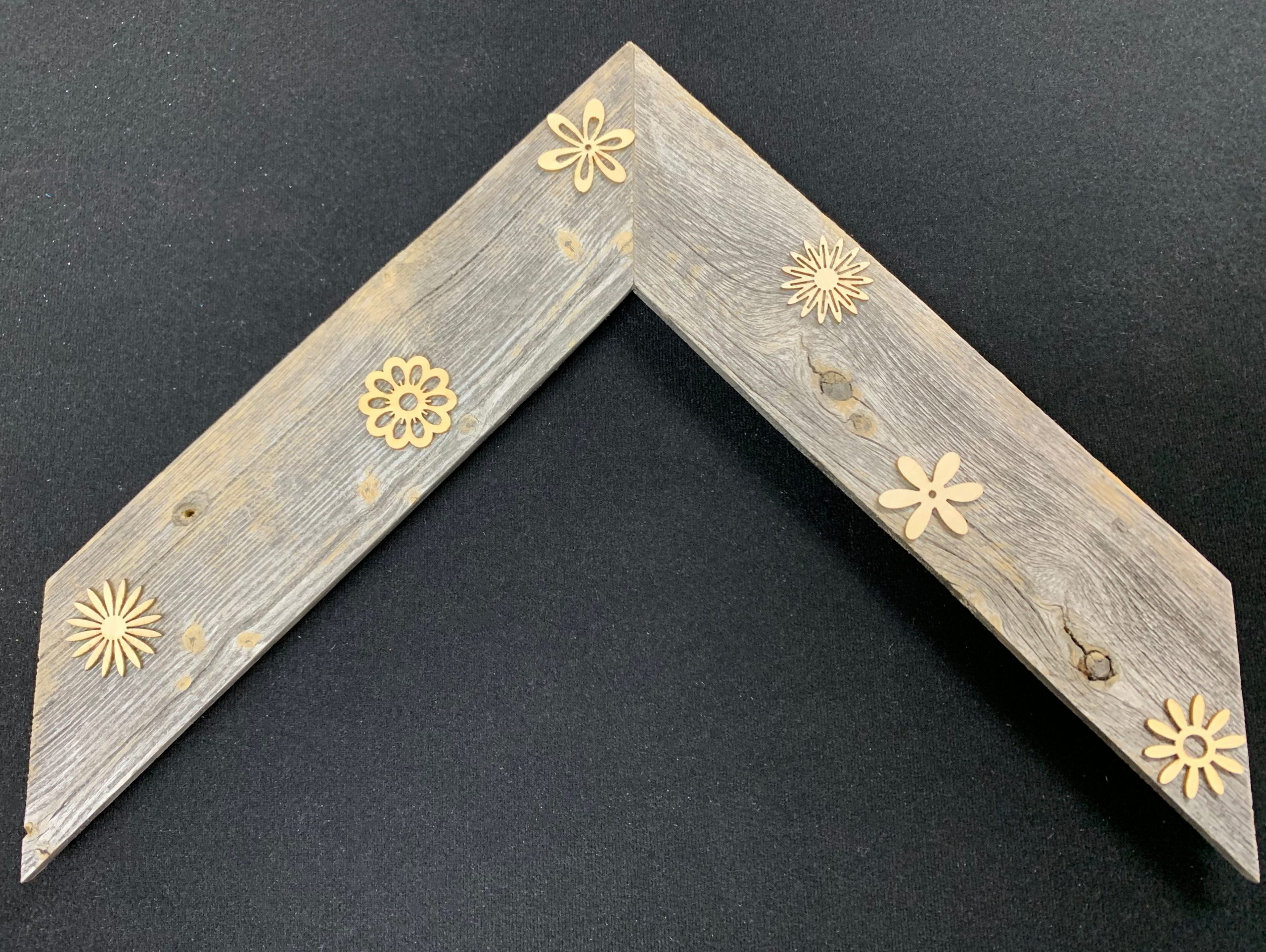 Barnwood enhanced with laser cut wood flowers